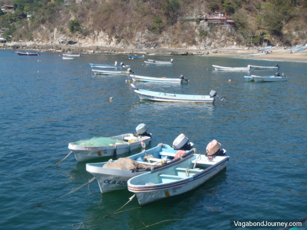 Fishing boats anchored vagabond journey travel stories for Angel boats and motors